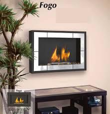 Foyer Fogo semi-encastré   Dim:37 1/4 long x 23 hauts x 7 profonds,couleur noir et stainless.Prix $899